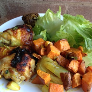 yummy baked chicken served with roasted sweet potatoes and onion with a fresh green salad